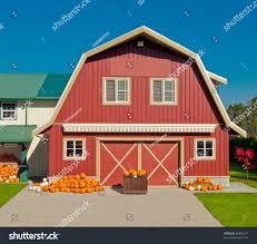 vintage red barn pumpkins upfront sunny stock photo 89968141