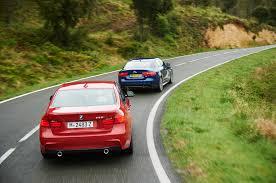 lexus gs300 vs bmw 530i bmw 335i m sport vs jaguar xe s head 2 head comparison motor trend