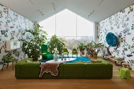 Green Sofa Living Room Green Sofa White Blue Living Room Patterened Wallpaper Interior