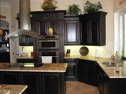 white kitchen cabinets with granite countertops and dark floors