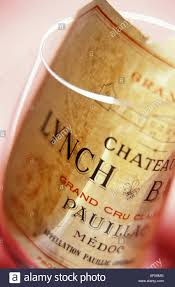 wine from château lynch bages wine label from chateau lynch bages in empty wine glass stock