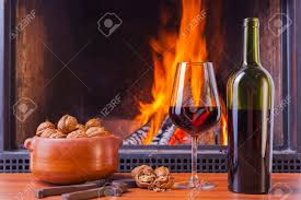 relaxing drinks at cozy warm fireplace in winter stock photo