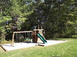 outdoor a slide and a swing in the yard and then grass plus