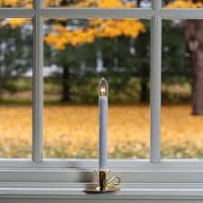 cordless led window candle with bronze finish adjustable height