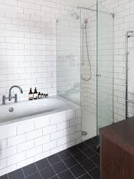 white brick wall tiles with small glass shower for cheap bathroom