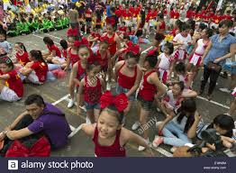 a group of schoolchildren participate in a contest parades in ho