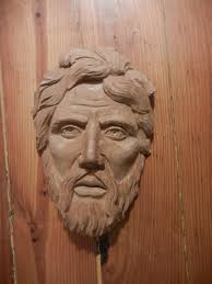 wood carving and stone carving faces