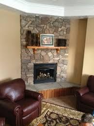 modern stone corner fireplace home design ideas