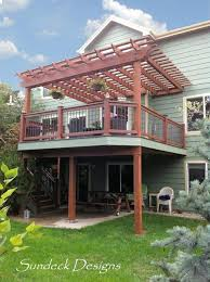 Pergola Deck Designs by Elevated Evergrain Deck With Pergola Traditional Deck Denver
