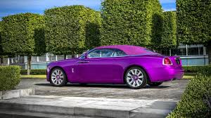 roll royce sport car rolls royce dawn in fuxia is a play on words