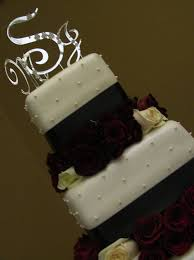fondant black white red wedding cake with fresh red roses with