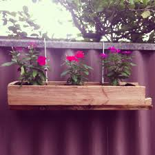 custom diy hanging wood planter boxes using recycled wood with