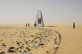 stone desert stone plane crash tribute emerges from desert is visible from