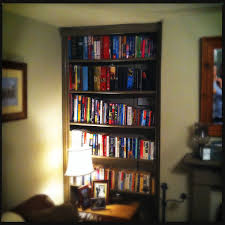 simple homemade library bookcase shelving with decorative surround