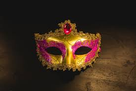 venetian mask golden venetian mask on a wooden table photo free