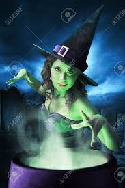 green and purple halloween background witch on a dark background stock photo picture and royalty
