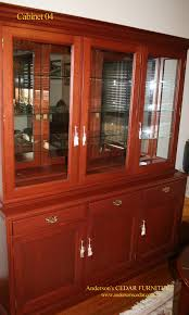 grandiose clear glass door brown finished mahogany cabinets as
