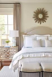 gray bedroom with mirrored nightstand under window transitional
