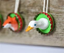 animals in bottle cap frames things to make and do
