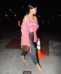 rihanna hoop earrings rihanna wears tank top that has the name of muhammad ali in nyc