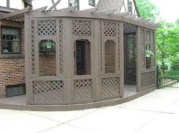 wood pergola with diagonal lattice by elyria fence