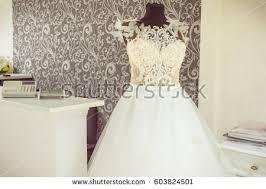 shop wedding dresses wedding dresses hanging on hanger fashion stock photo 533843164