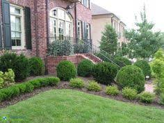 Formal Front Yard Landscaping Ideas - formal front yard stone wall urn columns front yard