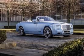 roll royce garage rolls royce million dollar bespoke program set sales records in