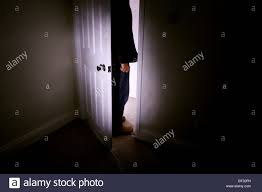 Male Figuere Standing Outside A Bedroom Or Any Room With Door