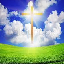 shiny wooden easter cross green field and blue sky with sun