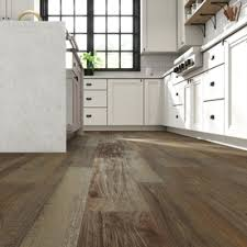 white kitchen cabinets with vinyl plank flooring smartcore pro claremount oak 7 08 in x 48 03 in waterproof interlocking luxury vinyl plank flooring 16 54 sq ft