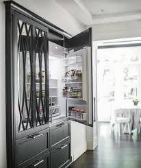 fridge that looks like cabinets black kitchen with two subzero refrigerators paneled to look like