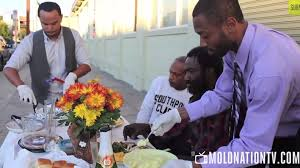homeless give advice to guys feeding them a thanksgiving meal