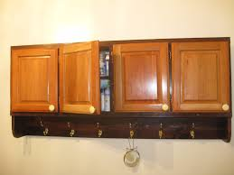 rustic varnished oak wood bathroom wall cabinets with towel hooks