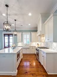 kitchen paint ideas raindrop blue kitchen with white cabinets and lantern chandeliers