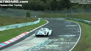 porsche 918 spyder on nordschleife in martini racing stripe flat