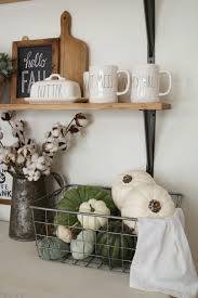 farmhouse kitchen shelves decorated for fall read the blog post