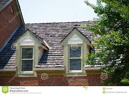 two dormers on brick homes with wood shingles stock images image