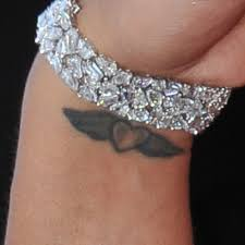 cassie u0027s heart u0026 wings wrist tattoo steal her style