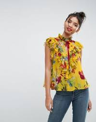 high neck ruffle blouse yellow floral sleeveless blouse with ruffle front textured woven