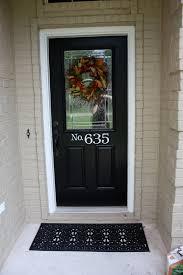 brown doors white trim after tan painted brick with black door