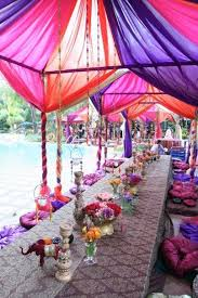 Colourful Ribbon Canopy Wedding Reception by Exotic Themed Party Sheer Fabrics Canopy And Bamboo Poles