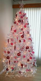 white tree with pink ornaments rainforest islands ferry