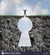 businessman standing on keyhole mountain cliff as a person with