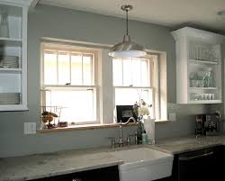 glass windows that flower and tissue on the marble countertop