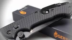 hinderer cls folding knife black nylon handle black blade comboedge