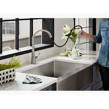 kitchen cabinet sink faucets matte black single or three kitchen sink faucet with 16 5 8 pull spout docknetik magnetic system and a 3 function sprayhead