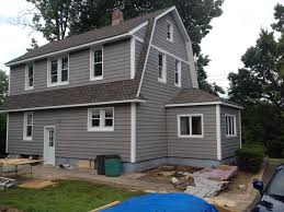 dutch colonial slate gray siding western highway house