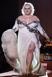 beth ditto wears a very revealing gown as she proudly storms the