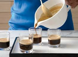 iced espresso macchiato what a macchiato really is huffpost